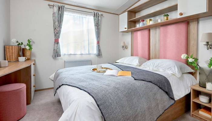 A lovely master bedroom at Grondre Holiday Park